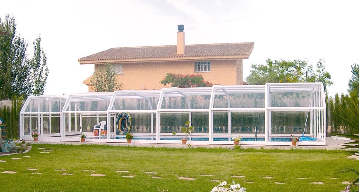 Abri de piscine haut t lescopique 2 abris piscine for Abri telescopique